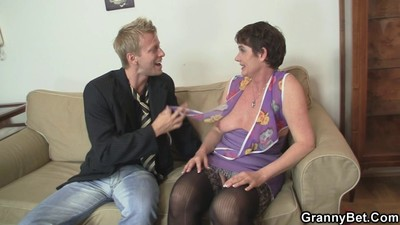 Naughty granny jumps on..
