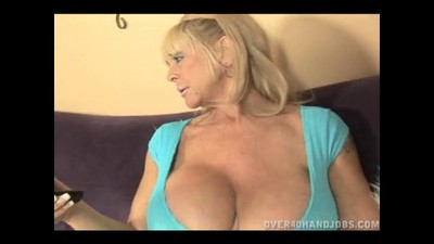 Blonde Granny With Huge Tits..