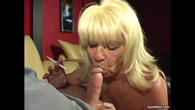 Busty blonde gives head..