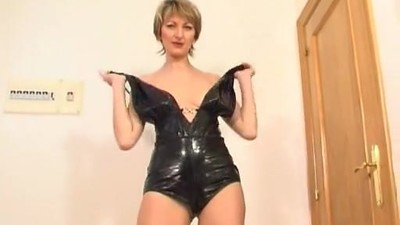MILF in a leather outfit..