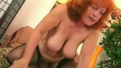 Redhead Granny in Stockings..