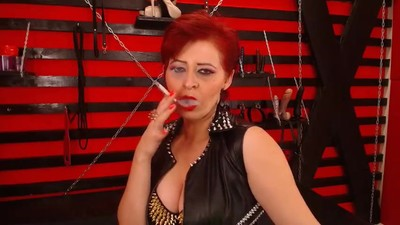 Seductive Red Head Dom Milf..