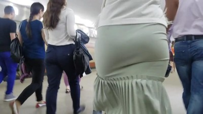 MILF's ass in tight skirt